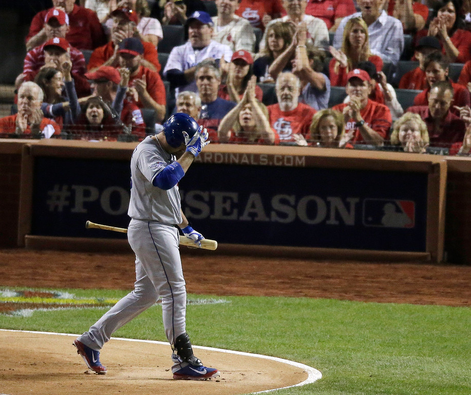 . Los Angeles Dodgers\' Adrian Gonzalez walks back to the dugout after striking out with runners on first and second during the first inning of Game 1 of the National League baseball championship series against the St. Louis Cardinals Friday, Oct. 11, 2013, in St. Louis. (AP Photo/Chris Carlson)