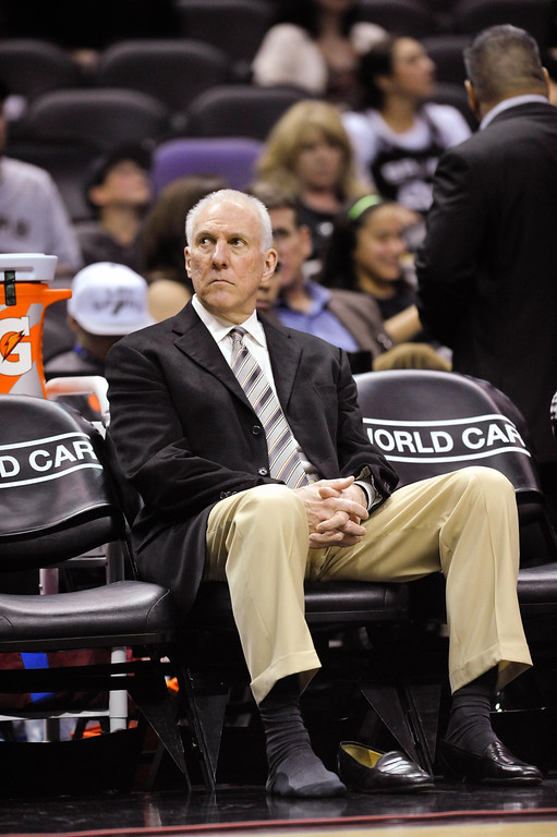 . San Antonio Spurs coach Gregg Popovich waits on the bench prior to the second half of an NBA basketball game against the Los Angeles Lakers on Friday, March 14, 2014 in San Antonio. (AP Photo/Bahram Mark Sobhani)