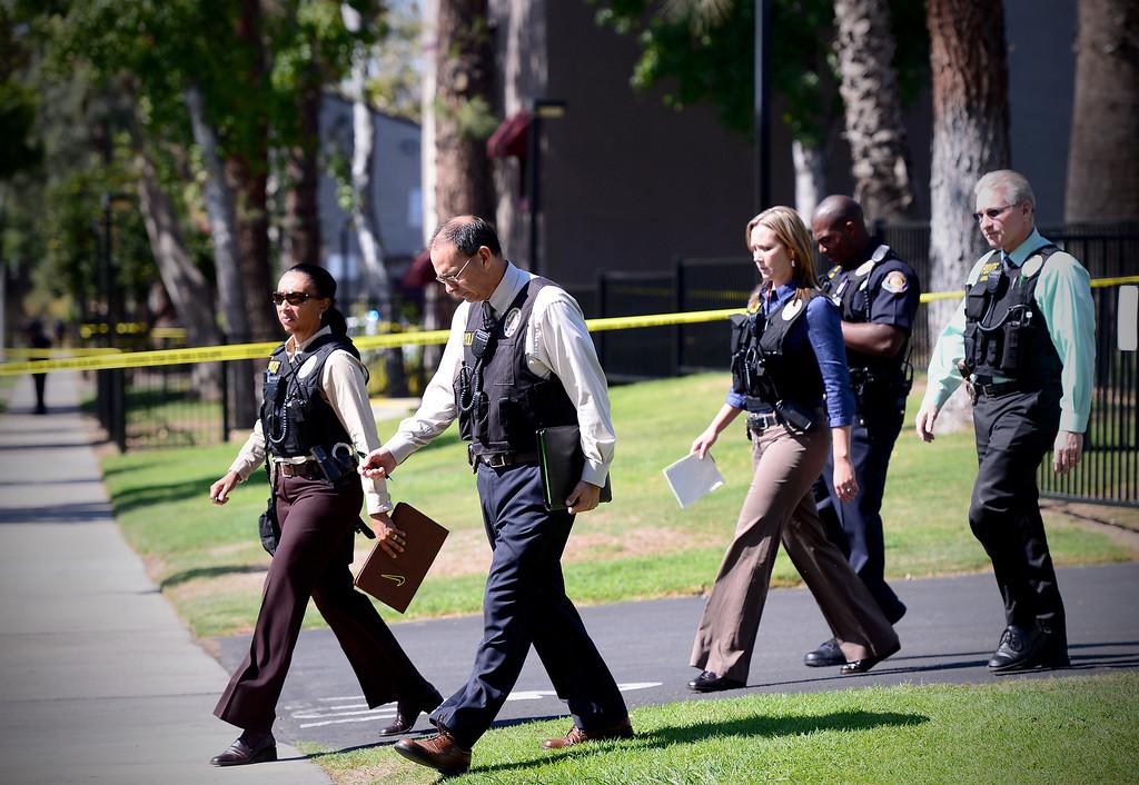 . Pasadena Police investigate an officer involved shooting at Kings Village in Pasadena Friday, October 11, 2013. (Photo by Sarah Reingewirtz/Pasadena-Star News)