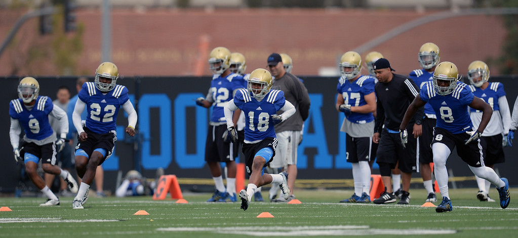 . UCLA defensive backs drill during football practice at Spaulding Field on the UCLA campus Thursday, April 17, 2014. (Photo by Hans Gutknecht/Los Angeles Daily News)