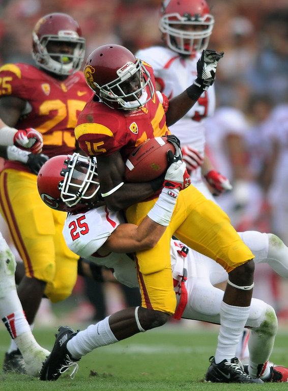 . USC\'s Nelson Agholor is dragged down by Utah\'s Mike Honeycutt in the third-quarter, Saturday, October 26, 2013, at the L.A. Memorial Coliseum. (Michael Owen Baker/L.A. Daily News)