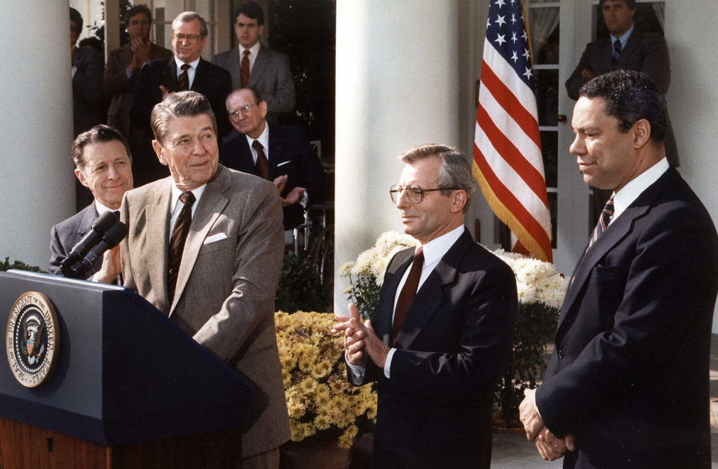 . US President Ronald Reagan (C) announces  in this 05 November 1987 file photo, at the White House, in Washington, DC, that he has selected National Security Advisor Frank Carlucci (2nd R) to succeed Caspar Weinberger(L) as US Defense Secretary. He also named Army Lt. General Colin Powell (R) to succeed Carlucci.  (MIKE SARGENT/AFP/Getty Images)