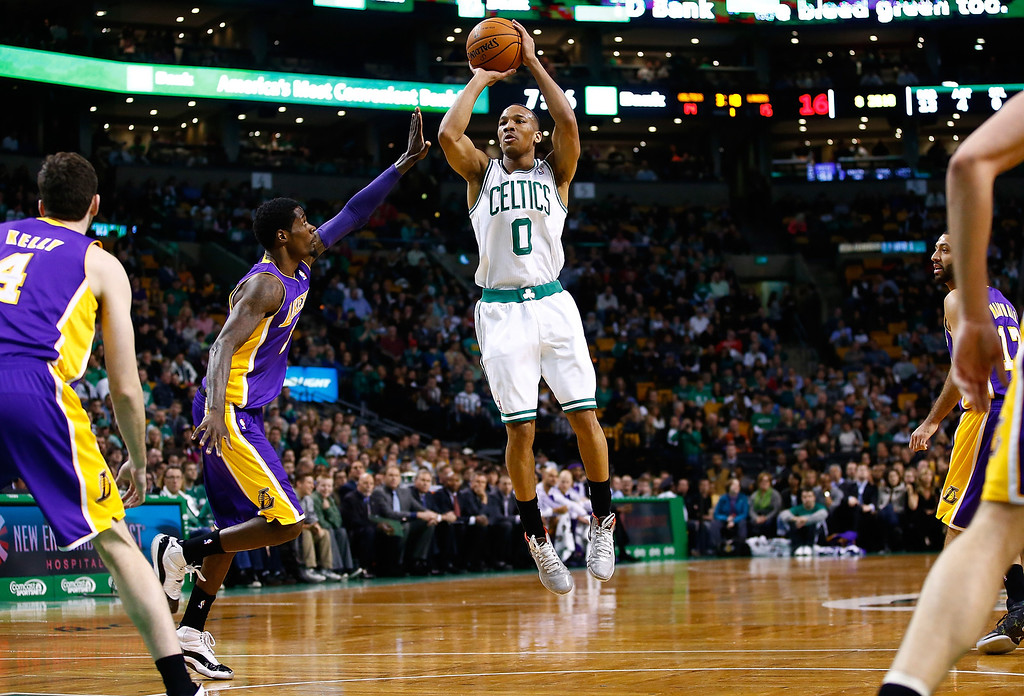 . BOSTON, MA - JANUARY 17: Avery Bradley #0 of the Boston Celtics takes a shot against the Los Angeles Lakers in the first quarter during the game at TD Garden on January 17, 2014 in Boston, Massachusetts.   (Photo by Jared Wickerham/Getty Images)
