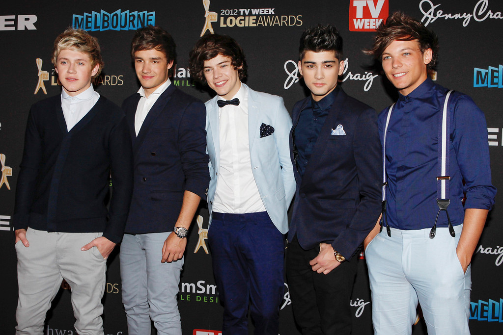 ". This is a Sunday, April 15, 2012 file  photo of British boy-band One Direction arrive for the Logies, an Australian television industry awards night, in Melbourne, Australia. One Direction\'s latest single sums it up. ""Live While We\'re Young\"" is the first track off their second album, and the boys are happy to have it as a motto. The members of the British pop group admit they\'re making the most of being young, successful and extremely popular. (AP Photo/Paul Jeffers, File)"