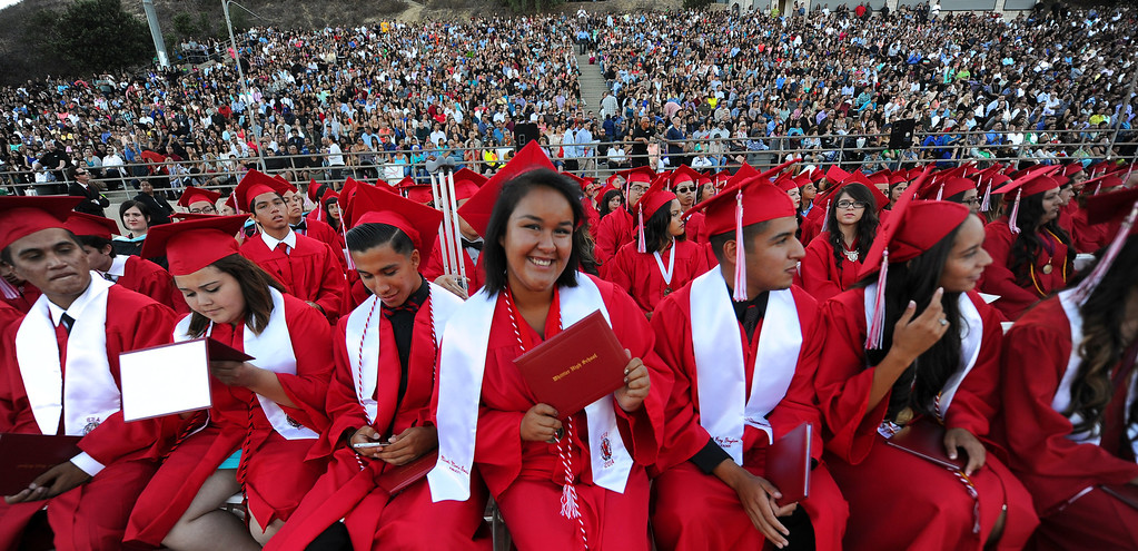 . Graduate Nicole Garcia shows off her diploma during the Whittier High School graduation at Whittier College in Whittier, Calif., on Wednesday, June 4, 2014.  (Keith Birmingham/Pasadena Star-News)