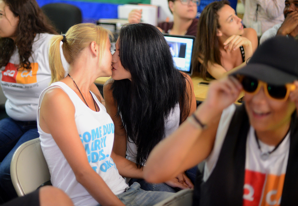 . Kirsty Hood, United Kingdom, and Nora Tautit, Australia,  celebrate with a kiss at Equality California in West Hollywood after the Supreme Court struck down the Defense of Marriage Act Wednesday, June 26, 2013. Equality California is the largest lesbian, gay, bisexual and transgender rights organization in California. (Hans Gutknecht/Los Angeles Daily News)