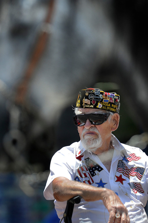 """. Lou Baarda,89, is a WWII Veteran who was wounded fighting under Gen. George Patton during the \""""Battle of the Bulge.\"""" He said that he got hit with 5 rounds from a machine gun, and laid in the snow for 6 hours because the medic in his unit got killed. Here Baarda gets an unclose view of horses in the parade. The Annual Canoga Park Memorial Day Parade marched down Sherman Way from Owensmouth east to Mason Street where it concluded at the First Baptist Church. Canoga park, CA 5/27/2013(John McCoy/LA Daily News)"""