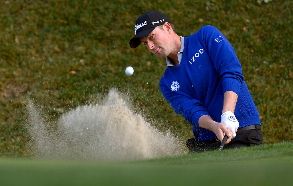 . Webb Simpson hits a shot out of the bunker on the 5th hole during the first-round of Tiger Woods\' Northwestern Mutual World Challenge at Sherwood Country Club in Thousand Oaks, CA Thursday December 5, 2013.(Andy Holzman/Los Angeles Daily News)