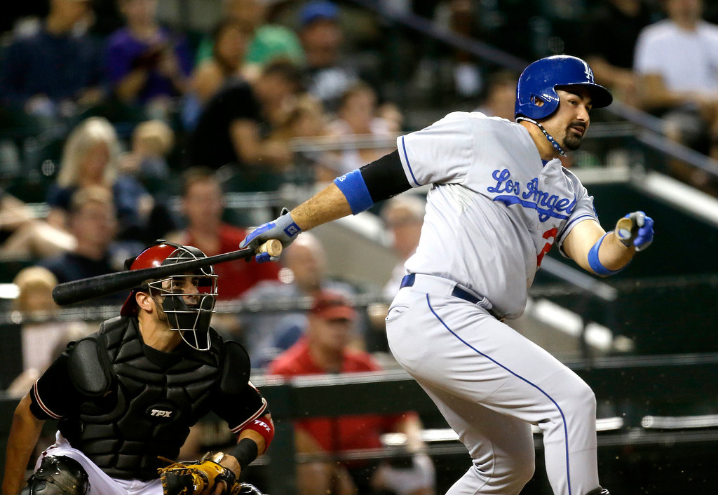 . Los Angeles Dodgers\' Adrian Gonzalez hits against the Arizona Diamondbacks during the fourth inning of a baseball game, Wednesday, July 10, 2013, in Phoenix. (AP Photo/Matt York)