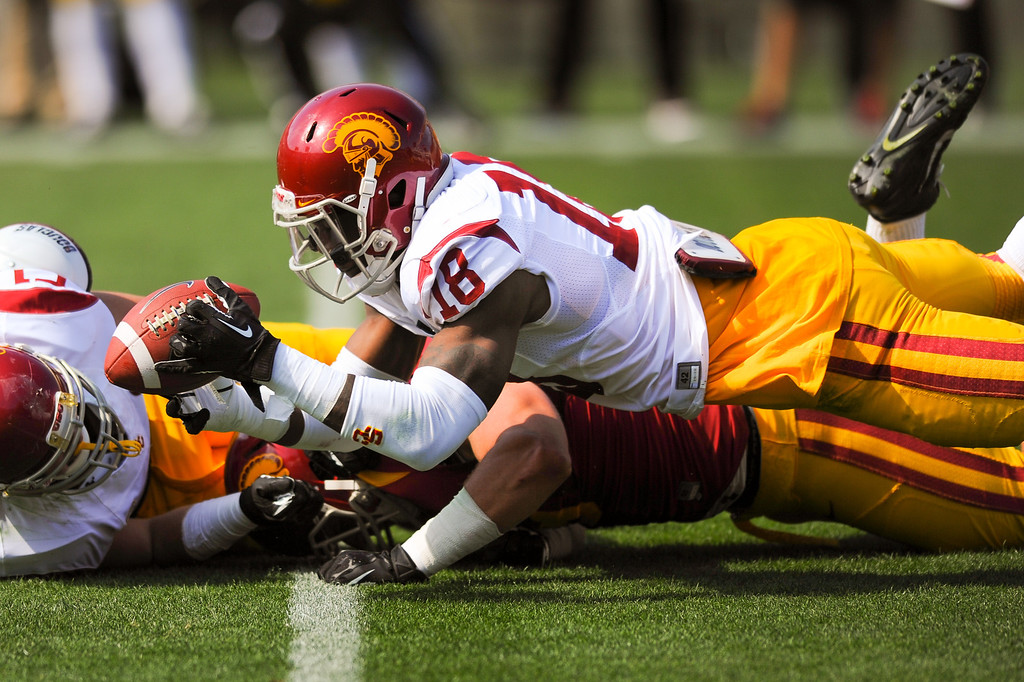 . USC LB Quinton Powell dives for a tipped pass that fell incomplete during the spring game. (Photo by Michael Owen Baker/L.A. Daily News)