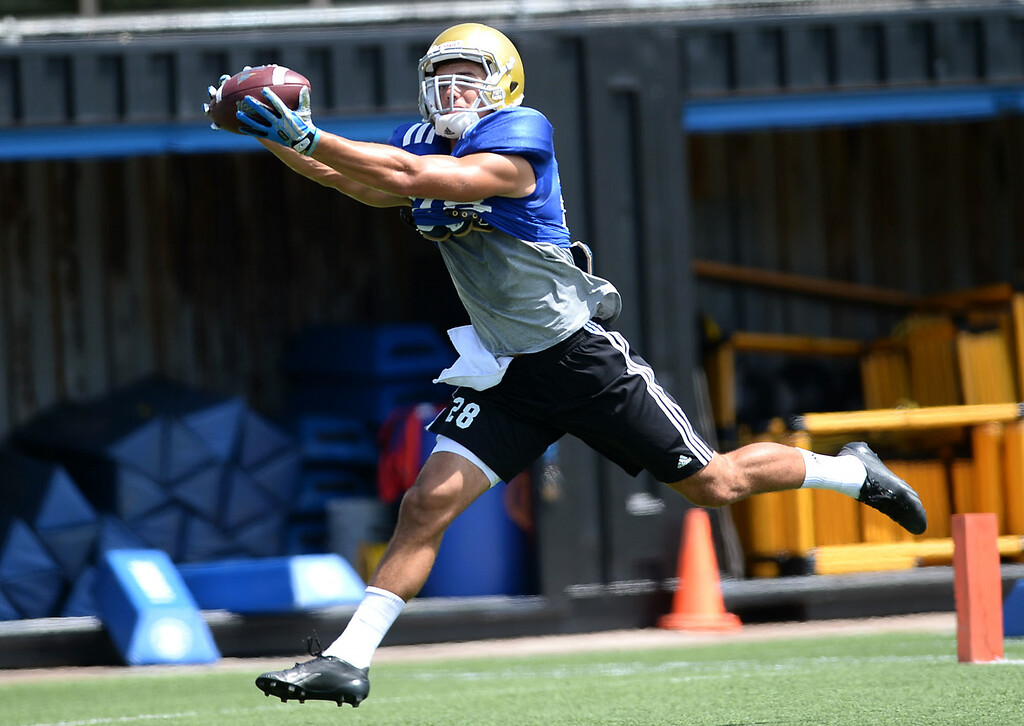 . UCLA\'s Taylor Lagace hauls in a pass during practice at Spaulding Field Friday, August 22, 2014.(Andy Holzman/Daily News Staff Photographer)