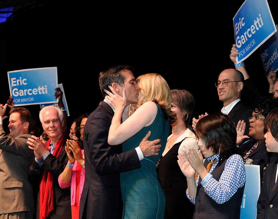 . Los Angeles Mayoral candidate Eric Garcetti kisses his wife Amy Wakeland after his speech. Garcetti held his election night party at The Hollywood Palladium where supporters showed hear him speak. Hollywood, CA 5/22/2013(John McCoy/LA Daily News)