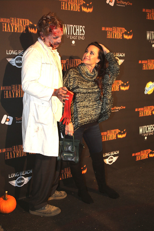 . An actor and Kyle Richards at the 5th Annual Los Angeles Haunted Hayride Premiere Night on October 10, 2013.  The fifth year anniversary of the Los Angeles Haunted Hayride took Hayriders through scenes of actual hauntings.  The month-long event will once again take place in Griffith Park�s Old Zoo area, which has been home to murder, torture, paranormal activity, serial killers, and abduction. (Photos by Boris Issaei for the Los Angeles Daily News)