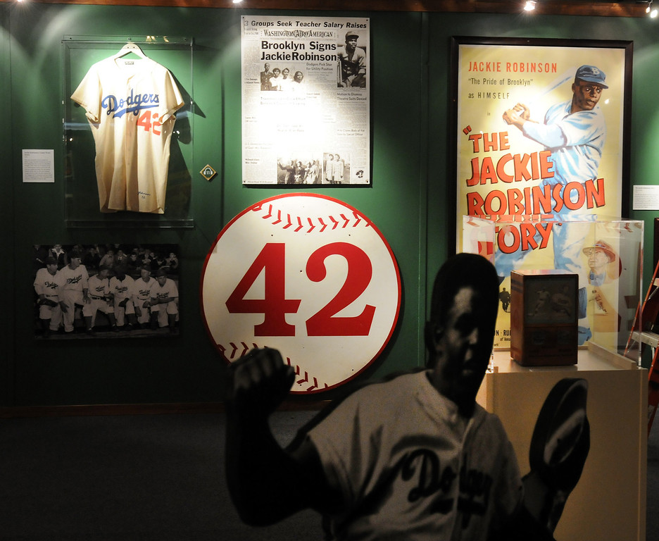 """. A section devoted to Jackie Robinson is included in the \""""Baseball!\"""" exhibit.The Exhibition opens April 4, 2014 at the Ronald Reagan Presidential Library and Museum.  Running through September 4, 2014, Baseball is a 12,000 square foot exhibition featuring over 700 artifacts, including some of the rarest, historic and iconic baseball memorabilia.  (Photo by Dean Musgrove/Staff Photographer)"""