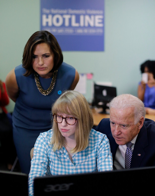 . Vice President Joe Biden, right, and actress Mariska Hargitay, left,  visit the headquarters of the National Domestic Violence Hotline to help commemorate National Domestic Violence Awareness Month, Wednesday, Oct. 30, 2013, in West Lake Hills, Texas. (AP Photo/Eric Gay, POOL)