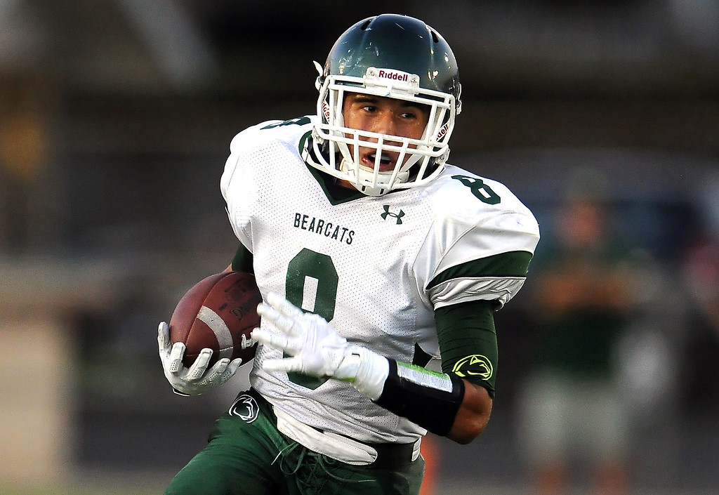 . Bonita\'s Christian Ramos runs for a first down against South Hills in the first half of a prep football game at Covina District Field in Covina, Calif. on Friday, Sept. 6, 2013.   (Photo by Keith Birmingham/Pasadena Star-News)