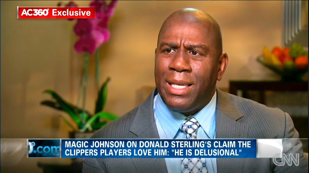 """. In this image taken from video provided by CNN, Magic Johnson talks with host Anderson Cooper at studios in Los Angeles in an interview broadcast Tuesday, May 13, 2014. Johnson says Los Angeles Clippers owner Donald Sterling is \""""living in the stone ages\"""" in his attitudes about minorities, and was shocked such a prominent man would have such ignorant views on HIV and AIDS. Sterling made his first public comments Monday since racist recordings emerged last month and earned him a lifetime NBA ban. (AP Photo/CNN)"""