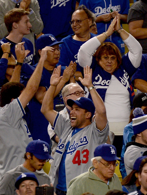 . The crowd celebrates Los Angeles Dodgers Carl Crawford\'s first home run during game 4 NLDS at Dodger Stadium Monday, October 7, 2013. (Photo by Sarah Reingewirtz/Los Angeles Daily News)