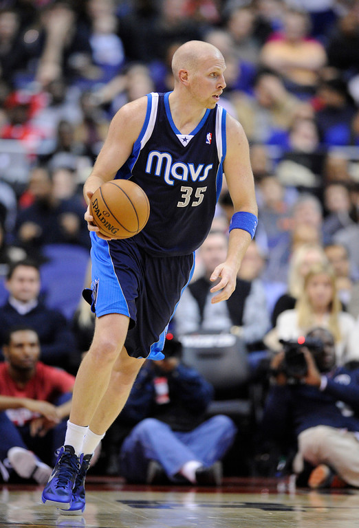 . Dallas Mavericks center Chris Kaman (35) dribbles the ball against the Washington Wizards during the first half of an NBA basketball game, Tuesday, Jan. 1, 2013, in Washington. (AP Photo/Nick Wass)