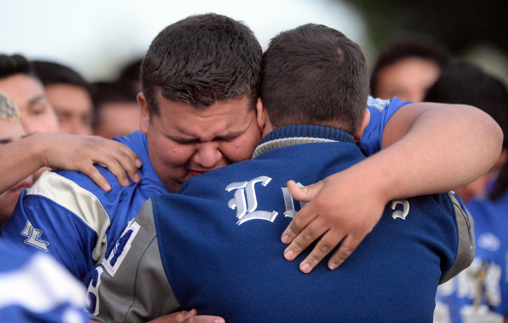 . Football teammate Justin Lopez cries after talking about his friend as family, students and members of the community gather in memory of Adrian Castro, 19, at El Monte High School Monday evening April 14, 2014. Castro was one of nine students killed in the bus crash in Orland, Calif. (Staff Photo by Keith Durflinger/San Gabriel Valley Tribune)