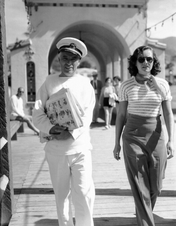 . Charlie Chaplin and Paulette Goddard stroll along the boardwalk at Catalina Island, southern California resort on August 18, 1934. They are vacationing on Chaplin�s yacht, the Panacea. (AP Photo)