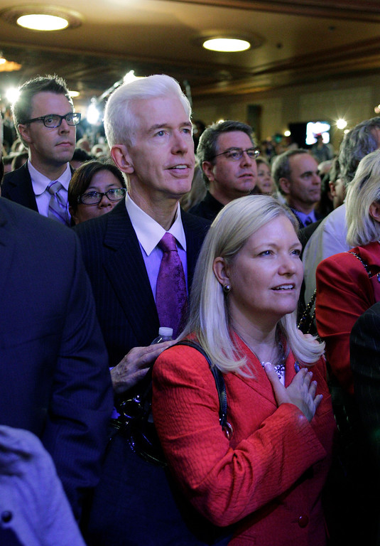 . Former California Gov. Gray Davis and his wife Sharon listen to the national anthem and wait for Democratic Gubernatorial candidate Jerry Brown to come on stage during an election night party in Oakland, Calif., Tuesday, Nov. 2, 2010. (AP Photo/Eric Risberg)