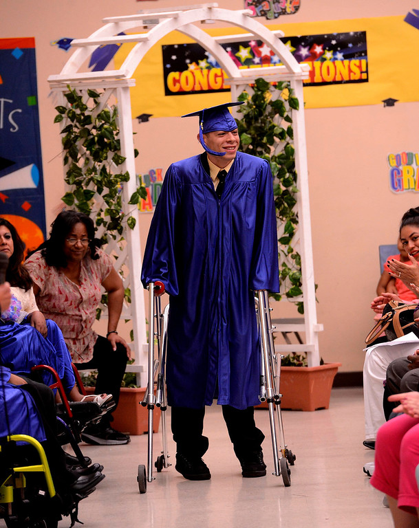 . Alfredo Yanez walks onto the stage during Commencement Ceremonies at Carl And Dora Anderson School in San Bernardino May 21, 2013.  GABRIEL LUIS ACOSTA/STAFF PHOTOGRAPHER.