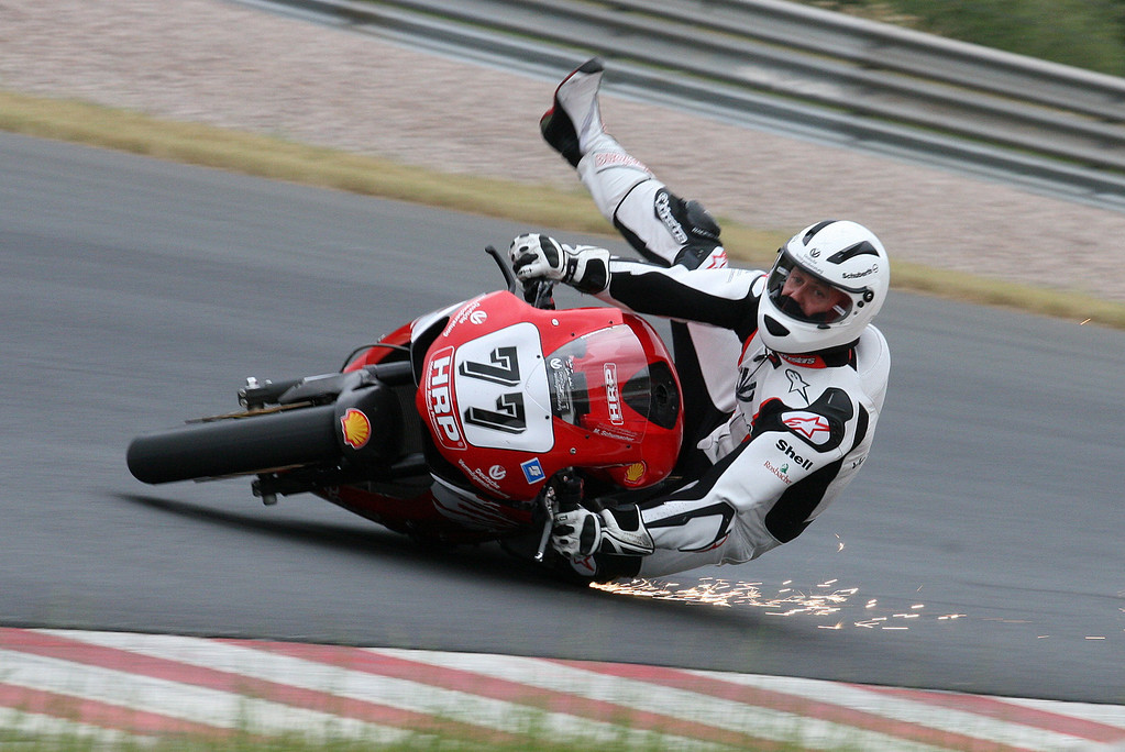 . Former German Formula One world champion Michael Schumacher falls during the free training for the IDM Superbike race at Sachsenring circuit near Zwickau, Germany, 12 June 2008. Schumacher remained uninjured. Photo by: Ralph Koehler/picture-alliance/dpa/AP Images