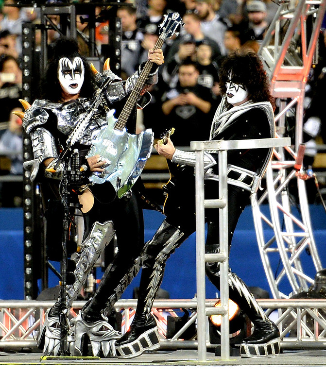 . Gene Simmons, left, along with Tommy Thayer of KISS perform prior to the inaugural NHL Stadium Series game between the Anaheim Ducks and the Los Angeles Kings at Dodger Stadium in Los Angeles on Saturday, Jan. 25, 2014. (Keith Birmingham Pasadena Star-News)