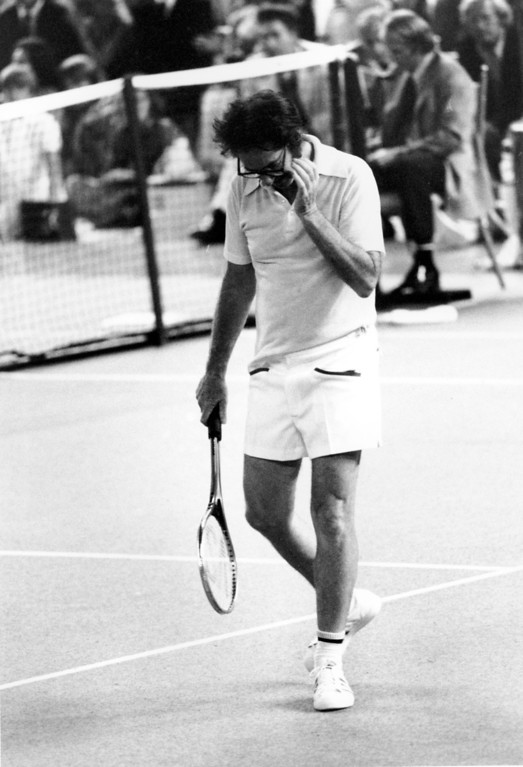 . Bobby Riggs walks off the court near the end of the third match in which Billie Jean King defeated the one-time champion of the courts to take the $100,000 winner-take-all tournament at the Houston Astrodome, Texas, on Sept. 20, 1973.  King won 6-4, 6-3, 6-3.  (AP Photo)