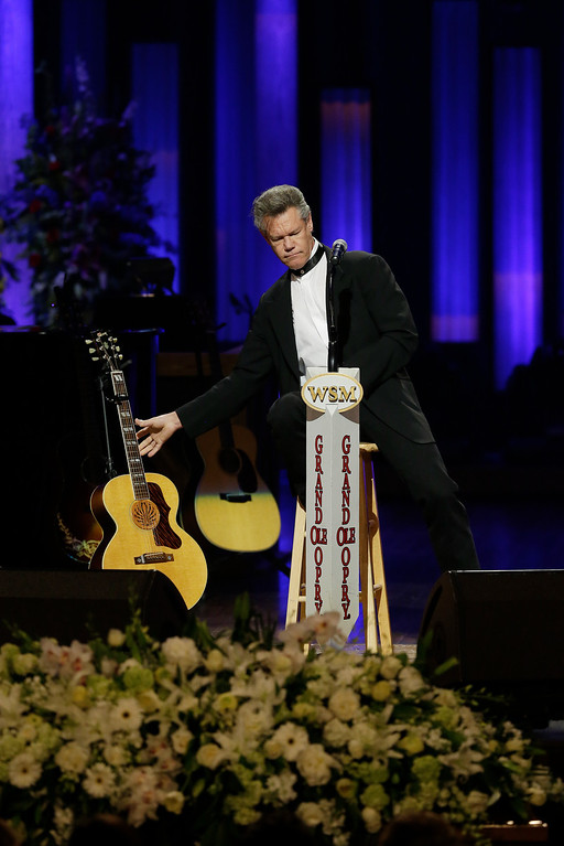 . Randy Travis performs during the funeral for country music star George Jones in the Grand Ole Opry House on Thursday, May 2, 2013, in Nashville, Tenn. Jones, one of country music\'s biggest stars who had No. 1 hits in four separate decades, died April 26.  (AP Photo/Mark Humphrey, Pool)
