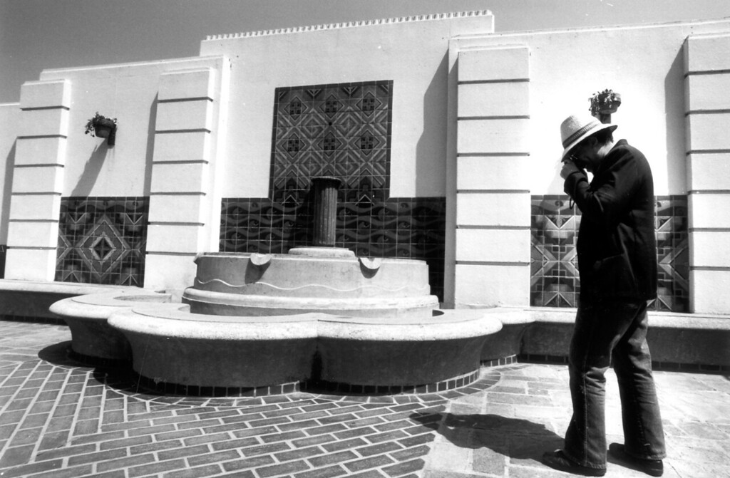 . Matthew Thomas, takes photographs of the fountain in the north courtyard at Union Station on April 30, 1991.    (Los Angeles Daily News file photo)