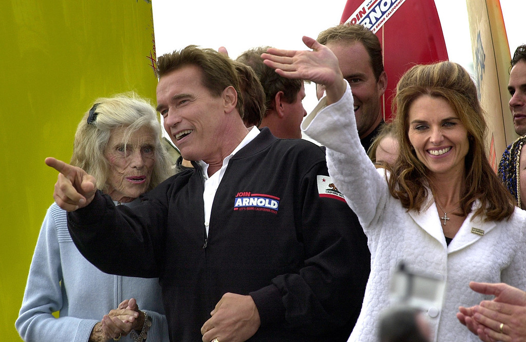 . 10/6/03 - Arnold Schwarzenegger candidate for California Governer talks to the mother of his wife Eunice Kennedy Shriver as his wife Maria Shriver waves at supporters at the Hungtington Beach Pier, a ralley the day before the recall election.Photo by David Waters/For the Press-Telegram