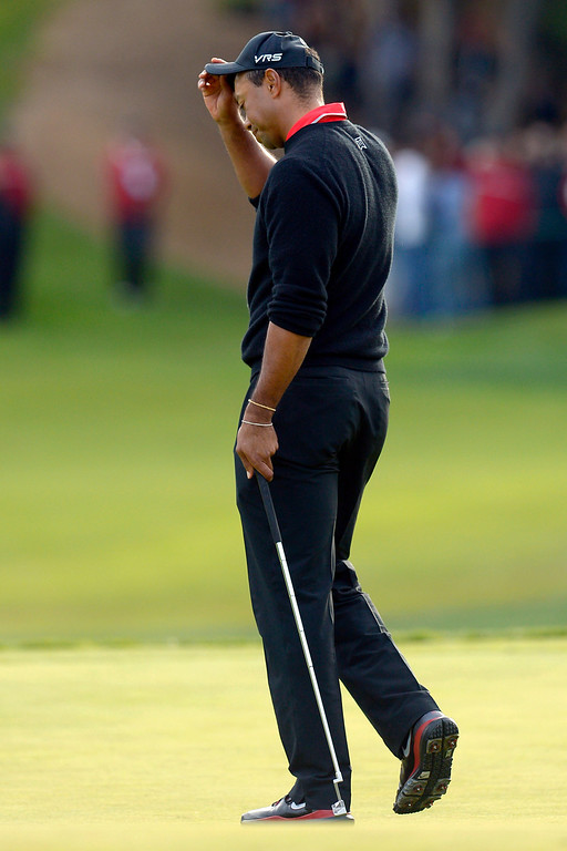 . Tiger Woods reacts after missing a 5-foot putt on a playoff hole against Zach Johnson during the final round of the Northwestern Mutual World Challenge golf tournament at Sherwood Country Club, Sunday December 8, 2013, in Thousand Oaks, Calif.   Johnson would go on to beat Tiger Woods on the hole.(Andy Holzman/Los Angeles Daily News)