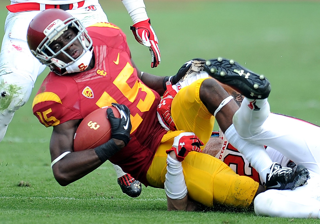 . Southern California wide receiver Nelson Agholor (15) catches a pas for a first down against Utah during the second half of an NCAA college football game in the Los Angeles Memorial Coliseum in Los Angeles, on Saturday, Oct. 26, 2013. Southern California won 19-3.   (Photo by Keith Birmingham/Pasadena Star-News)
