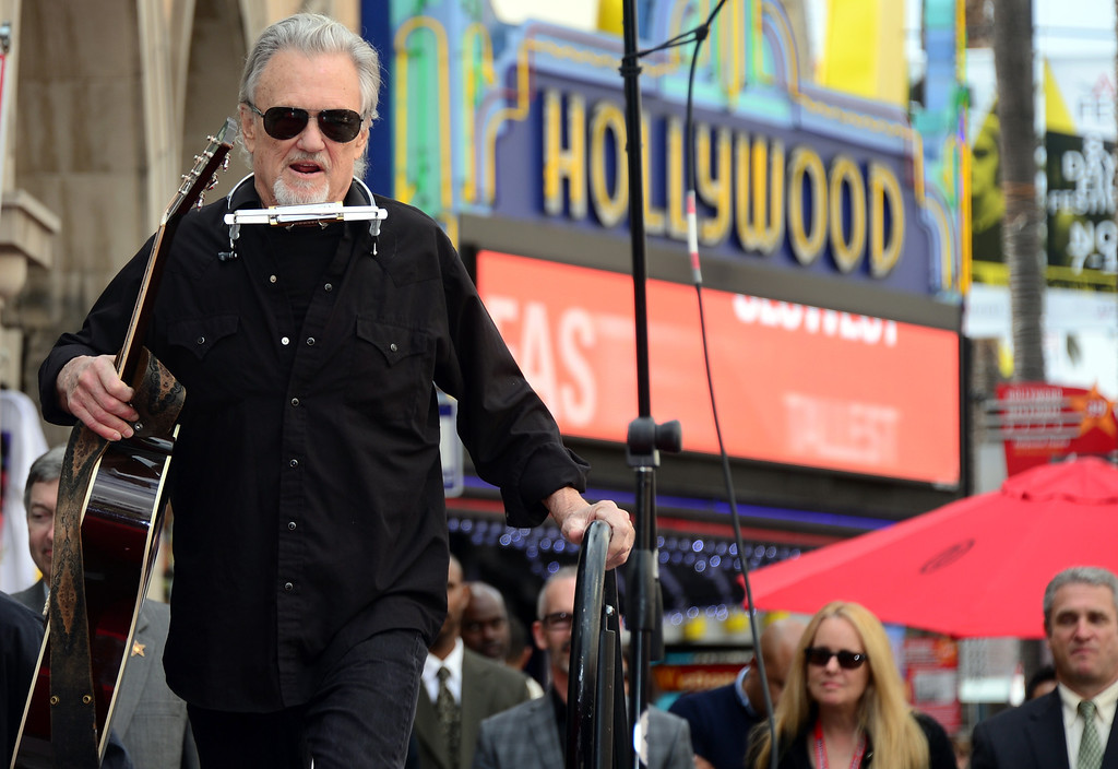 ". Kris Kristofferson arrives on stage to perform ""Me & Bobby McGee\"" live on Hollywood Boulevard during posthumous Star ceremony for the late Janis Joplin on November 4, 2013 in Hollywood, California. Joplin, who had her siblings Michael and Laura at the ceremony, would have turned 70 years old this year and is the recipient of the 2,510th Star on the Hollywood Walk of Fame in the Category of Recording.         (FREDERIC J. BROWN/AFP/Getty Images)"