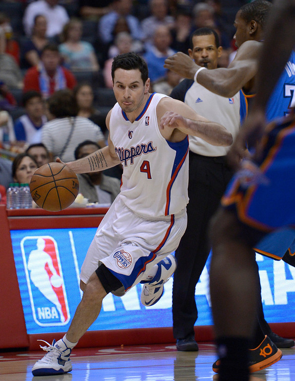 . Clippers#4 J.J. Redick drives to the lane. The Los Angeles Clippers played the Oklahoma City Thunder in a regular season game at Staples Center in Los Angeles, CA. 4/9/2014(Photo by John McCoy / Los Angeles Daily News)