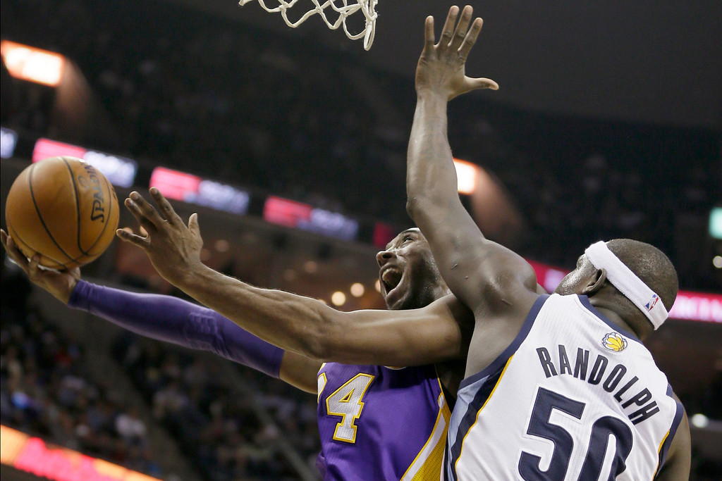 . Los Angeles Lakers\' Kobe Bryant goes to the basket in front of Memphis Grizzlies\' Zach Randolph (50) during the first half of an NBA basketball game in Memphis, Tenn., Tuesday, Dec. 17, 2013. (AP Photo/Danny Johnston)