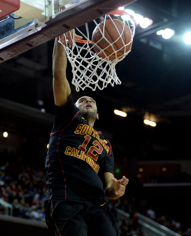 . Southern California\'s Julian Jacobs slam dunks in the second half of a PAC-12 NCAA basketball game against UCLA at Galen Center in Los Angeles, Calif., on Saturday, Feb. 8, 2014. UCLA won 83-73. (Keith Birmingham Pasadena Star-News)