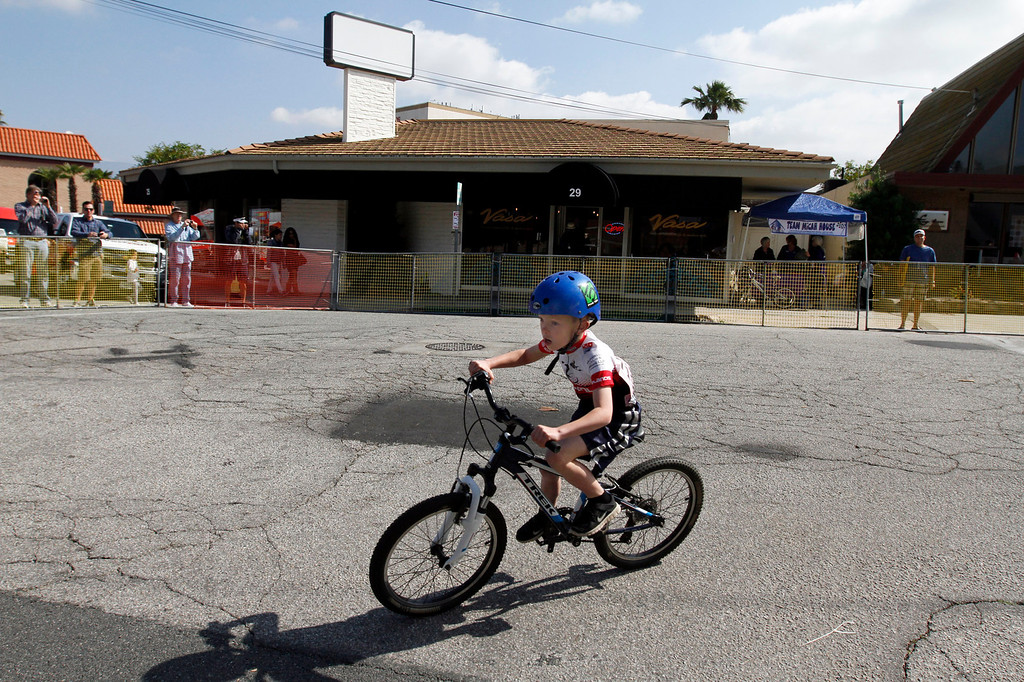 . A rider participates in the 7-year-old boys race during the Redlands Bicycle Classic on Saturday, April 5, 2014 in Redlands, Ca. (Photo by Micah Escamilla for the Redlands Daily Facts)