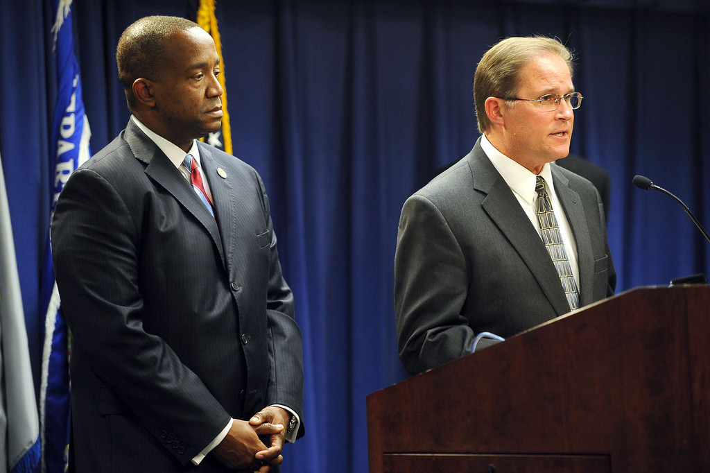 . United States Attorney Andre Birotte Jr. looks on as Bill Lewis, Assistant Director of FBI\'s Los Angeles Office, speaks during a press conference to announce that 18 members of the L.A. County Sheriff\'s Department are being charged with federal crimes including illegal beatings of jail inmates and obstruction of justice Monday, December 9, 2013 in Los Angeles, CA.  Federal authorities made the announcement after 16 of the defendants were taken into custody earlier today.(Andy Holzman/Los Angeles Daily News)