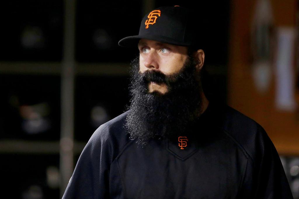 . FILE - In this Sept. 25, 2012, file photo, San Francisco Giants relief pitcher Brian Wilson looks on from the dugout during a baseball game against the Arizona Diamondbacks in San Francisco. Wilson is scheduled to throw Oct. 19 for the first time since Tommy John surgery, and the always-confident closer insists he will be full strength by next year. (AP Photo/Marcio Jose Sanchez, File)