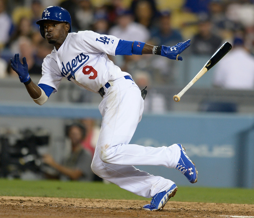 . Dee Gordon bunts. The Dodgers defeated the San Diego Padres 8-6 at Dodger Stadium. Los Angeles, CA. 8/19/2014(Photo by John McCoy Daily News)