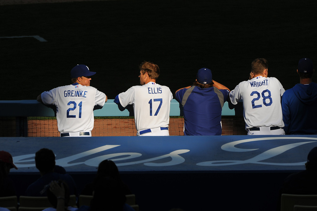 . Dodger catcher A.J. Ellis (#17) talks with pitcher Zack Greinke (#21) as shadows fall on the field at the Dodgers home opener, Friday, April 4, 2014, at Dodger Stadium. (Photo by Michael Owen Baker/L.A. Daily News)