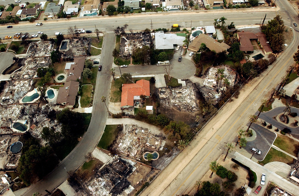 . Ten years ago this month the arson caused Old Fire, fanned by Santa Ana winds burned thousands of acres, destroyed hundreds of homes and caused six deaths. The fire burned homes in San Bernardino, Highland, Cedar Glen, Crestline, Running Springs and Lake Arrowhead and forced the evacuation of thousand of residents. A neighborhood lies destroyed, by the Old Fire, between Sterling Avenue, top, and Foothill Drive, curving on the right, in the Del Rosa area of San Bernardino.  Alto Drive can be seen in the center. (Staff file photo/The Sun)