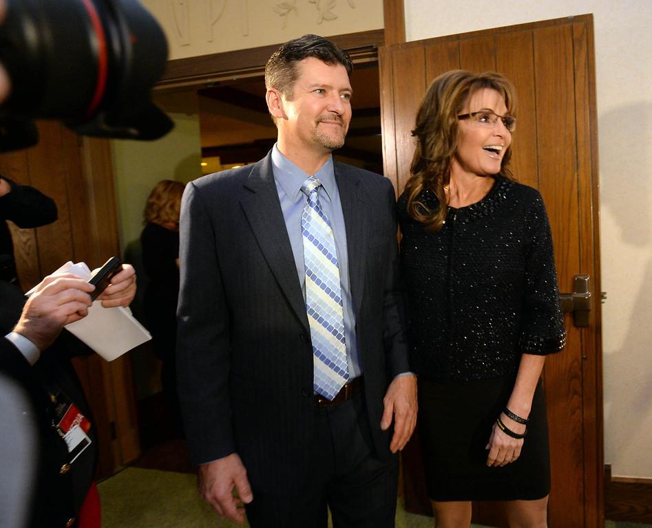 . Former Gov. of Alaska, Sarah Palin and her husband Todd arrive at the Grove Park Inn for a celebration of Billy Graham\'s 95th birthday in Asheville, N.C., Thursday, Nov. 7, 2013.  (AP Photo/The Charlotte Observer, Todd Sumlin)