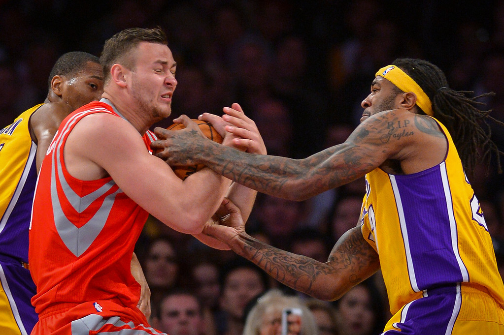 . Rockets� Donatas Motiejunas and Lakers� Jordan Hill battle for a jump ball during first half action at Staples Center Wednesday, February 19, 2014. ( Photo by David Crane/Los Angeles Daily News )