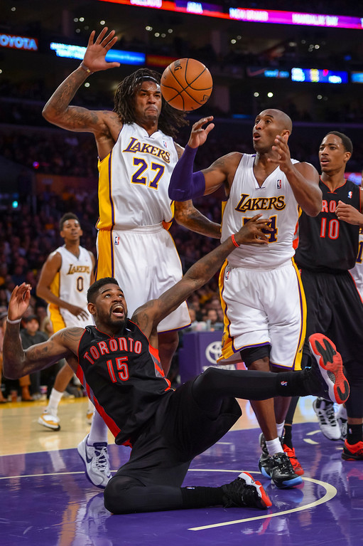 . Lakers� Kobe Bryant and Jordan Hill came up with the ball on this play as Raptors� Amir Johnson looses the ball on the rebound during second half action at Staples Center Sunday, December 8, 2013.  Lakers lost to the Raptors 94-106 as Bryant returned to action for the first time this season.  ( Photo by David Crane/Los Angeles Daily News )