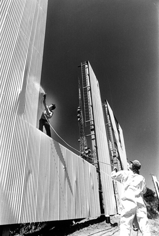. Painters working on the Hollywood sign to spruce it up for Olympics visitors.  7/26/84  (L.A. Daily News file photo)