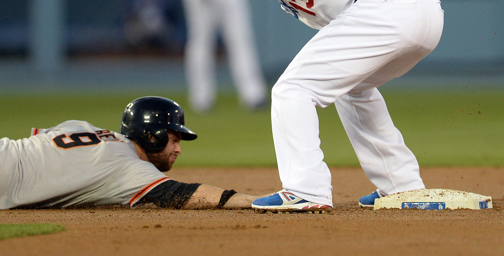 . The Giants\' Brandon Belt #9 slides back  to 2nd safely as the Dodgers Hanley Ramirez #13 attempts the tag on a pick off attempt during their game at Dodger Stadium Friday, May 9, 2014. (Photo by Hans Gutknecht/Los Angeles Daily News)
